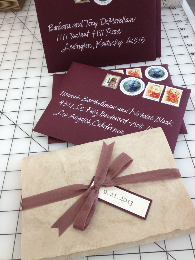 Wedding invitations for a charming couple . . . addressed by my wonderful calligrapher, Karen. Letterpress printing by Evolution Press. Don't you love the round stamp?