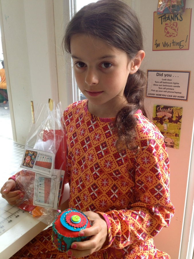 Mia, age 8 and her completed pincushion. She's an awesome seamstress!