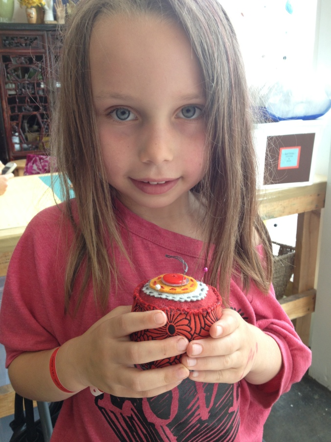 "Lydia, age 7, worked very hard to complete her pincushion. She is now a ""blanket stitch"" pro!"